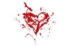 Красный выплеск краски сделал сердце влюбленности Стоковые Изображения RF
