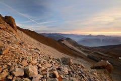 Красный высокогорный заход солнца Стоковое Фото
