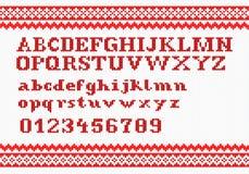 Красный вязать алфавит на белой предпосылке Стоковое фото RF