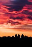 Красный головной правитель приносит красочный заход солнца Стоковые Фото