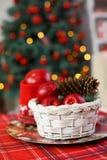 Красный деревянный фонарик под елью Стоковые Изображения