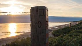Красный деревянный поляк на море Стоковое Фото