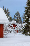 Красный деревянный финский дом Стоковые Изображения