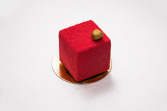 Красный десерт с гайками на верхней части стоковое изображение