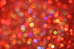 Красный, желтый, бирюза, фиолетовое абстрактное bokeh - совершенные рождество и предпосылка валентинки Стоковое фото RF