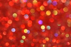 Красный, желтый, бирюза, фиолетовое абстрактное bokeh - совершенные рождество и предпосылка валентинки Стоковая Фотография