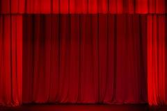 Красный занавес на этапе театра или кино открытом Стоковые Фото