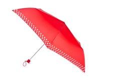 Красный зонтик с белыми многоточиями польки Стоковое Фото