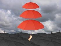 Красный зонтик третье наслаивает в предохранение от руки и дождя больше чем Стоковое фото RF