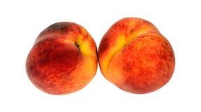 Красный зрелый сочный персик 2 на предпосылке Стоковое Изображение RF