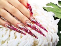 Красный дизайн на ногтях Стоковое Изображение RF