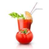 Красный изолированные томат и стекло сока стоковое фото rf