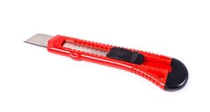 Красный изолированный нож канцелярских принадлежностей Стоковые Изображения