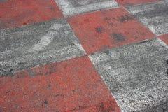 Красный и белый асфальт автогонок в Монако Стоковая Фотография RF