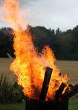 Красный и оранжевый дым огня стоковые фотографии rf