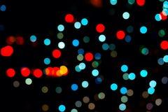 Красный и светлый - голубое bokeh на черноте стоковое фото rf
