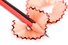 Красный и черный карандаш изолированный на белой предпосылке Стоковое Изображение