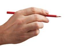 Красный карандаш в руке Стоковое Изображение