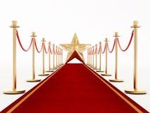 Красный ковер и бархат ropes с золотой звездой Стоковые Фото