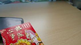 Красный конверт и бумажник Стоковое Изображение