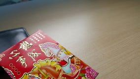 Красный конверт и бумажник Стоковое Фото