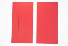Красный конверт на белой предпосылке Стоковые Изображения RF