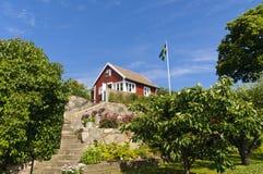 Красный коттедж в Швеции Стоковые Фотографии RF
