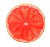 Красный кусок грейпфрута подсвеченный, изолированный на белизне Стоковое Фото