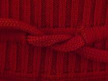 Красный макрос свитера смычка Стоковое фото RF