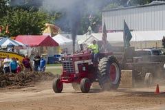 Красный международный трактор Turbo Стоковая Фотография