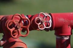 Красный металлический жидкостный огнетушитель Стоковая Фотография