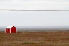 Красный дом в Исландии Стоковая Фотография RF