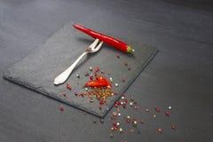 Красный пеец на вилке Стоковые Фото