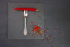 Красный пеец на вилке Стоковое фото RF