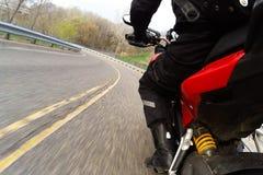 Красный поворачивать мотоцикла Стоковые Изображения RF