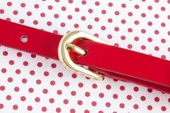Красный пояс на точках польки Стоковое Изображение RF