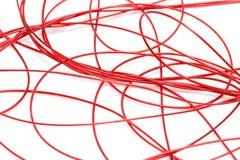 Красный провод на белой предпосылке Стоковое Фото
