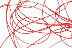 Красный провод на белой предпосылке Стоковая Фотография RF