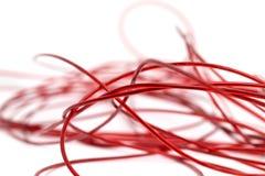 Красный провод на белой предпосылке Стоковые Изображения