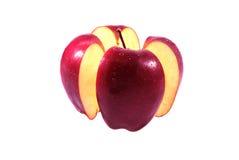 Красный пролом яблока на белой предпосылке Стоковая Фотография RF