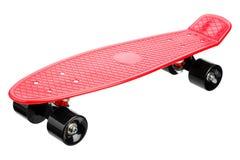 Красный пластичный скейтборд Стоковая Фотография RF