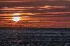 Красный рассвет на море Стоковые Фото