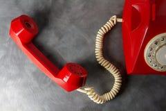 Красный ретро телефон Стоковые Изображения