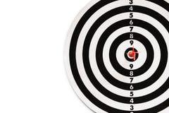 Красный дротик на красном пункте dartboard Стоковое Изображение
