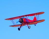 Красный самолет-биплан Стоковые Изображения RF