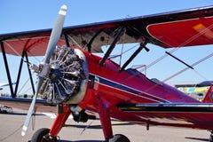 Красный самолет-биплан Стоковое фото RF