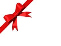 Красный смычок ленты изолированный на угловой белизне Стоковая Фотография