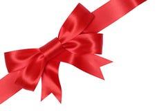 Красный смычок подарка для подарков на рождество, день рождения или день валентинок Стоковое Изображение RF