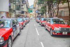 красный таксомотор стоковая фотография