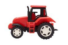 Красный трактор игрушки изолированный на белой предпосылке Стоковое Изображение RF